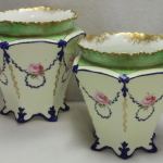Pair of Royal Crown Derby hand painted and gilded vases